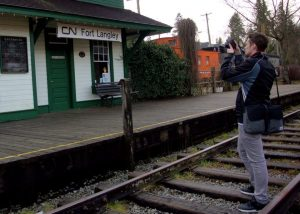 Brookswood Secondary School Grade 12 student Brayden Chapelas records video footage of the heritage CN Station in Fort Langley, 2016. Photo: Mark Forsythe.