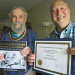 """Jay Sherwood receiving his certificate from Maurice Guibord for """"Surveying Southern British Columbia: A Photojournal of Frank Swannell, 1901-07""""."""