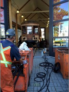 No. 1220 Interurban tram car is prepared for under-car cleaning and maintenance during the first stage of the restoration project. Photo courtesy City of Richmond.